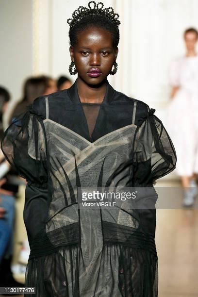 Adut Akech walks the runway at the Simone Rocha Ready to Wear Fall/Winter 20192020 fashion show during London Fashion Week February 2019 on February...