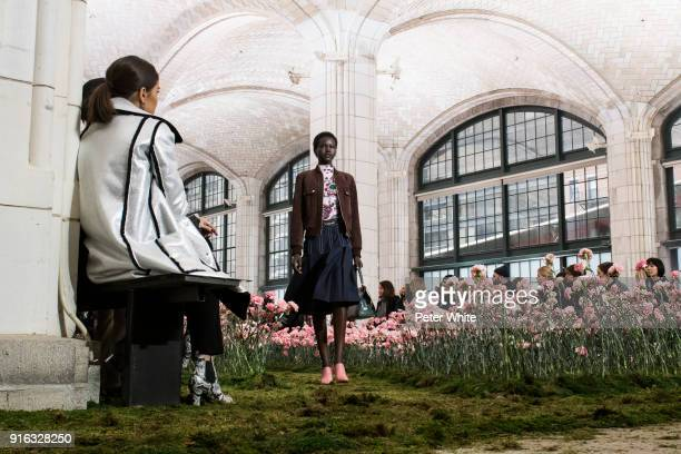 Adut Akech walks the runway at the Tory Burch Fall Winter 2018 Fashion Show during New York Fashion Week at Bridge Market on February 9 2018 in New...
