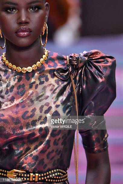 Adut Akech walks the runway at the Versace fashion show at the Milan Men's Fashion Week Spring/Summer 2020 on June 15 2019 in Milan Italy