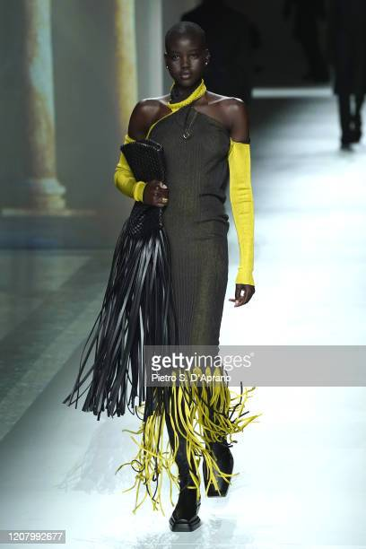 Adut Akech walks the runway during the Bottega Veneta fashion show as part of Milan Fashion Week Fall/Winter 20202021 on February 22 2020 in Milan...