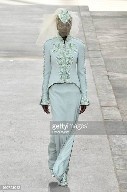 Adut Akech walks the runway during the Chanel Haute Couture Fall Winter 2018/2019 show as part of Paris Fashion Week on July 3 2018 in Paris France