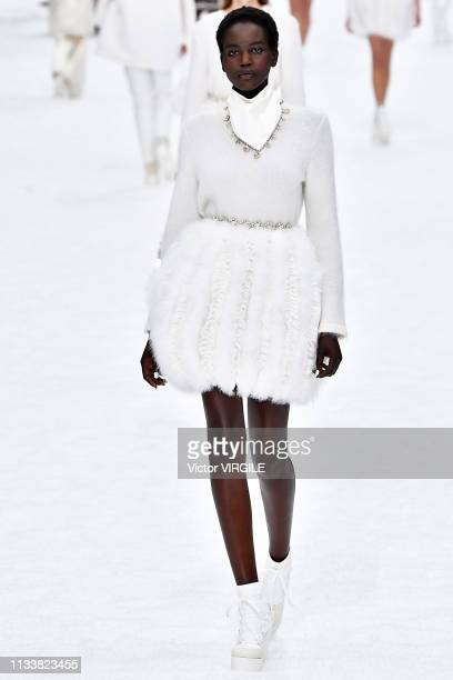 Adut Akech walks the runway during the Chanel Ready to Wear fashion show as part of the Paris Fashion Week Womenswear Fall/Winter 2019/2020 on March...