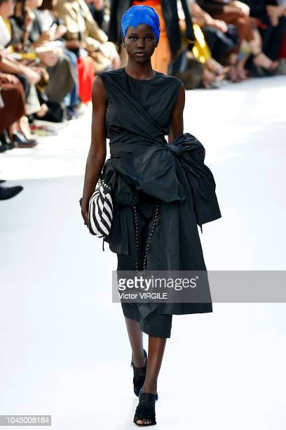 Adut Akech walks the runway during the Dries Van Noten Ready to Wear fashion show as part of the Paris Fashion Week Womenswear Spring/Summer 2019 on...