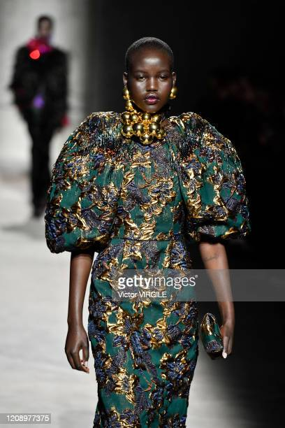 Adut Akech walks the runway during the Dries Van Noten Ready to Wear fashion show as part of the Paris Fashion Week Womenswear Fall/Winter 2020/2021...