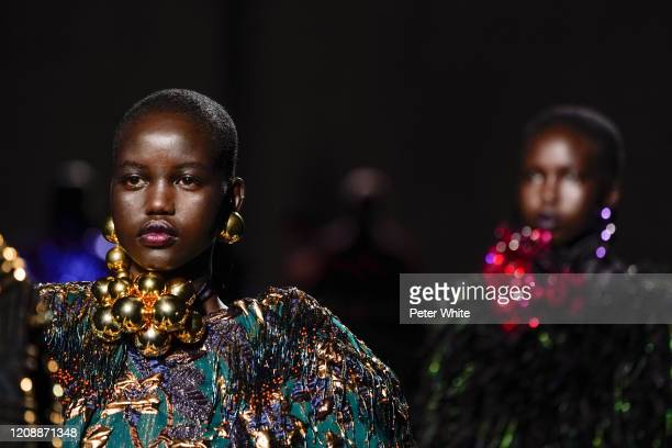 Adut Akech walks the runway during the Dries Van Noten show as part of the Paris Fashion Week Womenswear Fall/Winter 2020/2021 on February 26 2020 in...