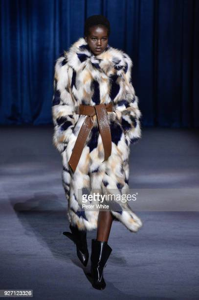 Adut Akech walks the runway during the Givenchy show as part of the Paris Fashion Week Womenswear Fall/Winter 2018/2019 on March 4 2018 in Paris...