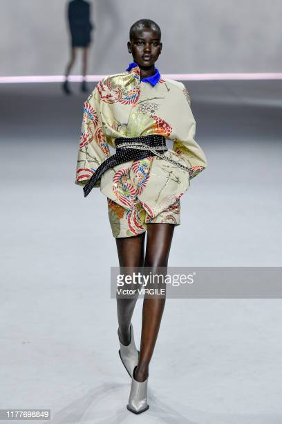 Adut Akech walks the runway during the Haider Ackermann Ready to Wear Spring/Summer 2020 fashion show as part of Paris Fashion Week on September 28,...