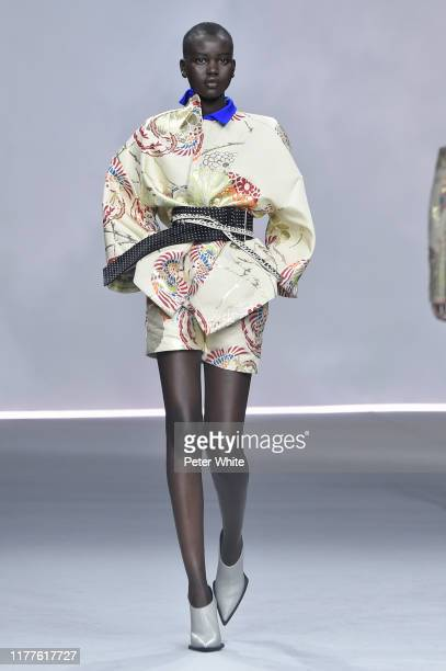 Adut Akech walks the runway during the Haider Ackermann Womenswear Spring/Summer 2020 show as part of Paris Fashion Week on September 28, 2019 in...