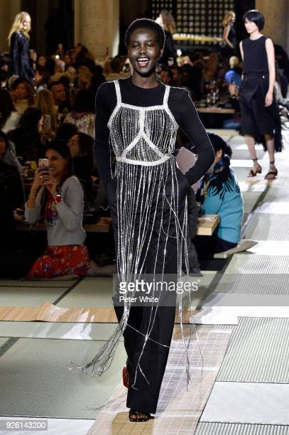Adut Akech walks the runway during the HM show as part of the Paris Fashion Week Womenswear Fall/Winter 2018/2019 on February 28 2018 in Paris France