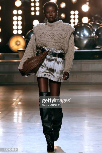 Adut Akech walks the runway during the Isabel Marant Ready to Wear fashion show as part of Paris Fashion Week Womenswear Fall/Winter 2019/2020 on...