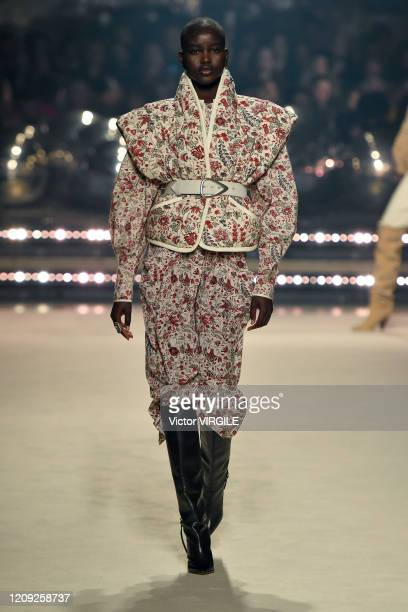 Adut Akech walks the runway during the Isabel Marant Ready to Wear fashion show as part of the Paris Fashion Week Womenswear Fall/Winter 2020/2021 on...