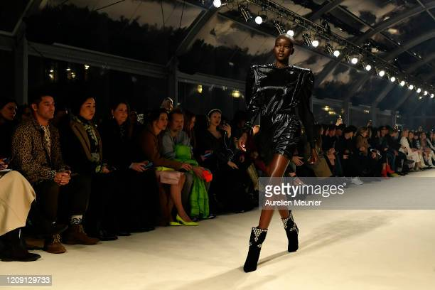 Adut Akech walks the runway during the Isabel Marant show as part of the Paris Fashion Week Womenswear Fall/Winter 2020/2021 on February 27 2020 in...