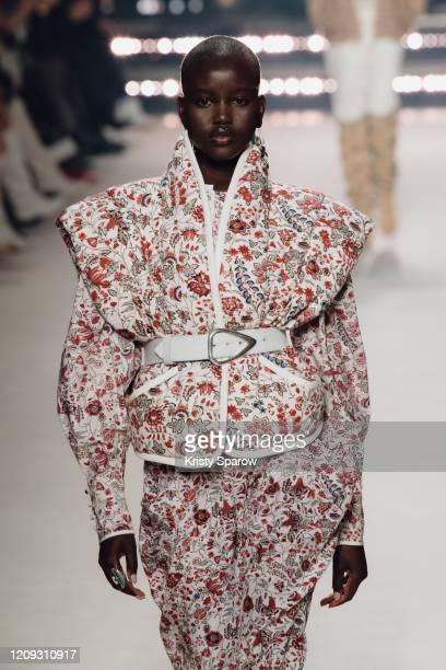 Adut Akech walks the runway during the Isabel Marant show as part of Paris Fashion Week Womenswear Fall/Winter 2020/2021 on February 27 2020 in Paris...