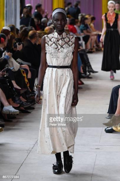 Adut Akech walks the runway during the Miu Miu Paris show as part of the Paris Fashion Week Womenswear Spring/Summer 2018 on October 3 2017 in Paris...
