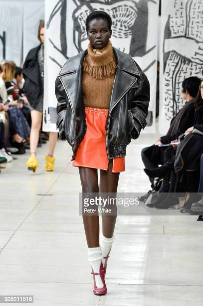 Adut Akech walks the runway during the Miu Miu show as part of the Paris Fashion Week Womenswear Fall/Winter 2018/2019 on March 6 2018 in Paris France