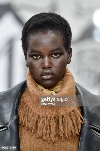 Adut Akech walks the runway during the Miu Miu show as part of the Paris Fashion Week Womenswear Fall/Winter 2018/2019 on March 6 2018 in Paris France