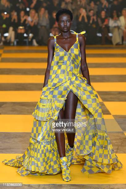 Adut Akech walks the runway during the Off-White Ready to Wear fashion show as part of the Paris Fashion Week Womenswear Fall/Winter 2019/2020 on...