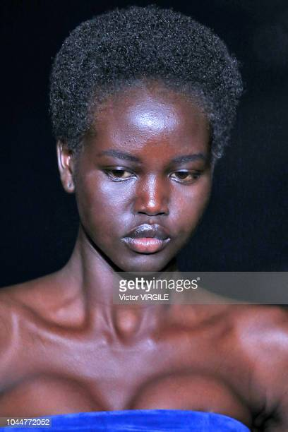 Adut Akech walks the runway during the Saint Laurent Ready to Wear fashion show as part of the Paris Fashion Week Womenswear Spring/Summer 2019 on...