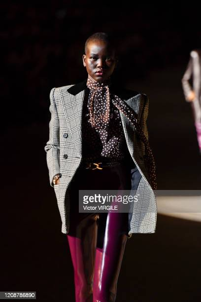 Adut Akech walks the runway during the Saint Laurent Ready to Wear fashion show as part of the Paris Fashion Week Womenswear Fall/Winter 2020/2021 on...