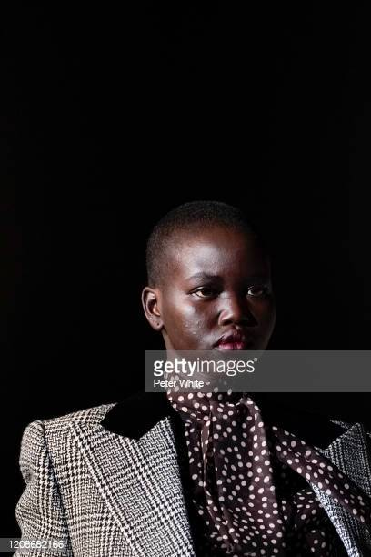 Adut Akech walks the runway during the Saint Laurent show as part of the Paris Fashion Week Womenswear Fall/Winter 2020/2021 on February 25 2020 in...