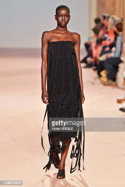 Adut Akech walks the runway during the Salvatore Ferragamo fashion show as part of Milan Fashion Week Fall/Winter 20202021 on February 22 2020 in...