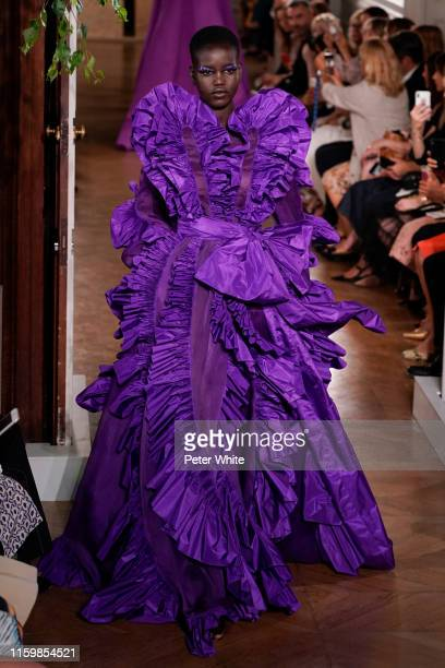 Adut Akech walks the runway during the Valentino Fall/Winter 2019 2020 show as part of Paris Fashion Week on July 03, 2019 in Paris, France.