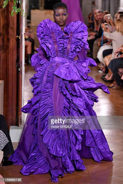 Adut Akech walks the runway during the Valentino Haute Couture Fall/Winter 2019 2020 show as part of Paris Fashion Week on July 03, 2019 in Paris,...