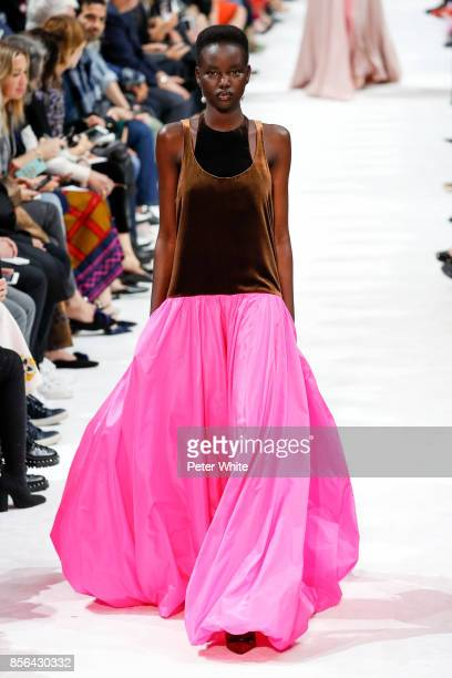 Adut Akech walks the runway during the Valentino show as part of the Paris Fashion Week Womenswear Spring/Summer 2018 on October 1 2017 in Paris...