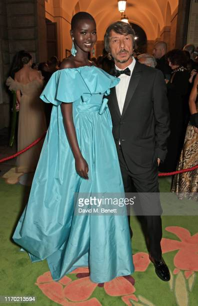 Adut Akech wearing Valentino and Valentino Creative Director Pierpaolo Piccioli attend The Green Carpet Fashion Awards, Italia 2019, hosted by CNMI &...
