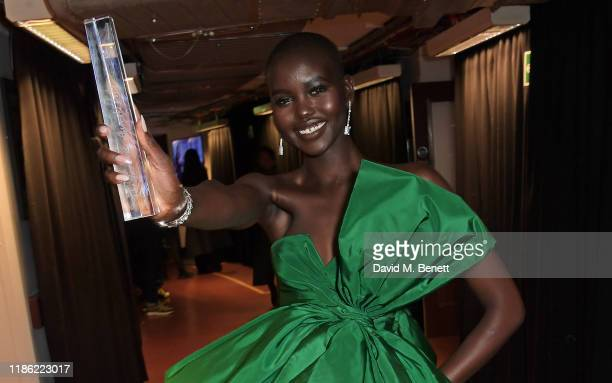 Adut Akech winner of Model of the Year poses backstage stage during The Fashion Awards 2019 held at Royal Albert Hall on December 2 2019 in London...