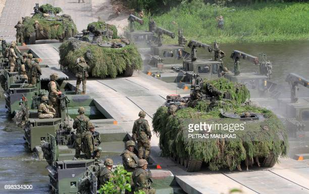 NATO advance force battalion group demonstrates a water obstacle crossing during an International exercise Iron Wolf 2017 /Saber Strike 2017' in...