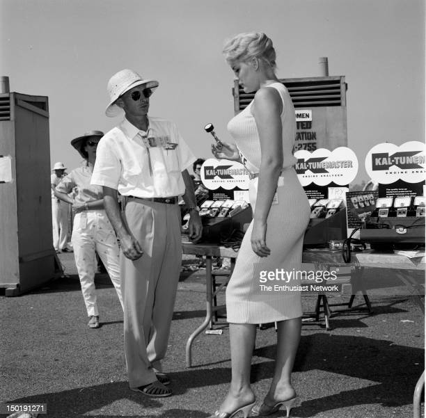 Advance Muffler Publicity Photos With June Wilkinson Wilkinson fresh off her pictorial in Playboy magazine lends her considerable talents to...