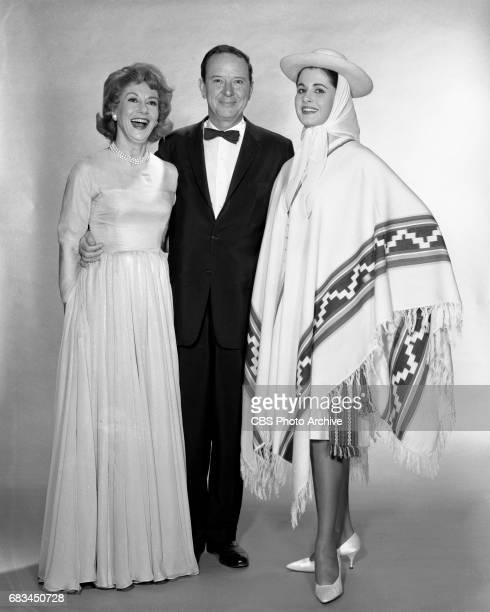 Advance photo session for the Miss Universe Beauty Pageant. Pictured from left is Arlene Francis, John Daly and Norma Beatriz Nolan of Argentina ....