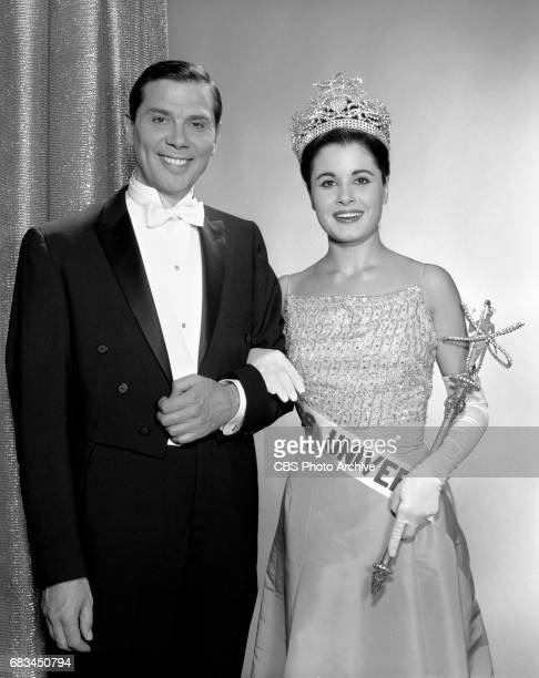 Advance photo session for the Miss Universe Beauty Pageant. Pictured is Gene Rayburn, emcee of the show from the stage and Norma Beatriz Nolan of...