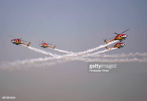 Advanced Light Helicopters of the Indian Air Force's Sarang aerobatics team perform during full dress rehearsal ahead of the 83rd Air Force Day on...