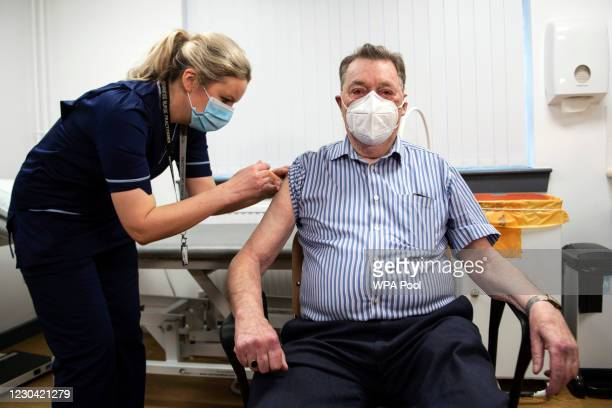 Advanced nurse practitioner Justine Williams administers a dose of the AstraZeneca/Oxford Covid-19 vaccine to 82-year-old James Shaw, the first...