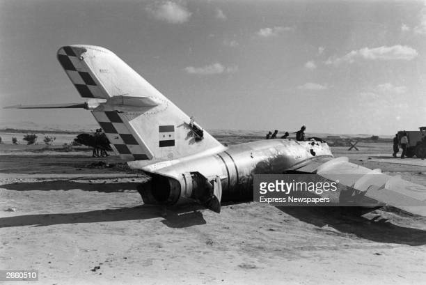 Advancing Israeli troops passing the wreckage of an enemy aeroplane near El Arish airport during the Six Day War