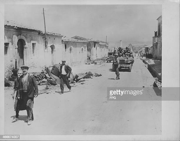 Advancing US troops in the town of Gela during World War Two Sicily Italy circa 19431945