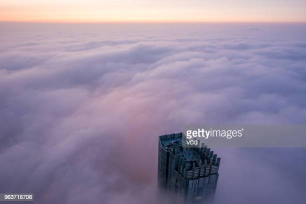 Advection fog surrounds office buildings and residential buildings on May 29 2018 in Yantai China
