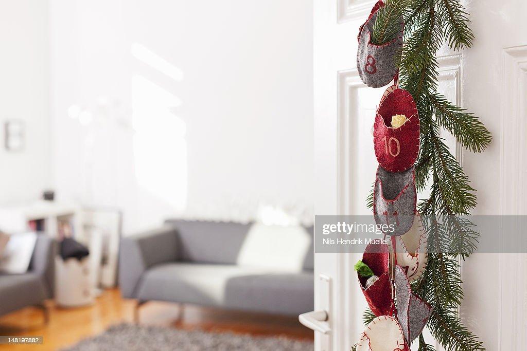 Advent calendar hanging on door : Stock Photo