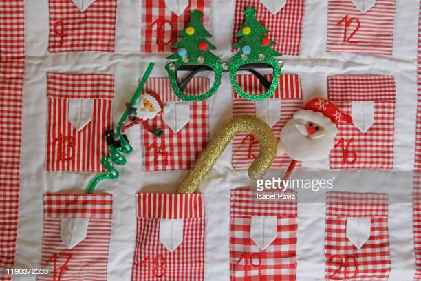 advent calendar with christmas gifts - advent calendar stock photos and pictures