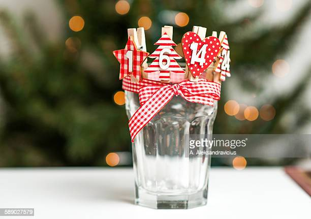 advent calendar with small hearts placed in glass - advent calendar stock photos and pictures