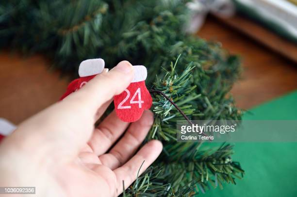 advent callendar count down oranaments on a table of gift wrapping - advent calendar stock photos and pictures