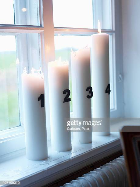 Advent candles on window sill