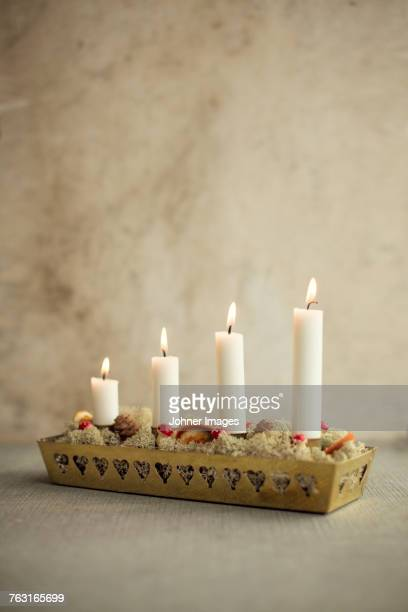advent candlestick - christmas decore candle stock pictures, royalty-free photos & images