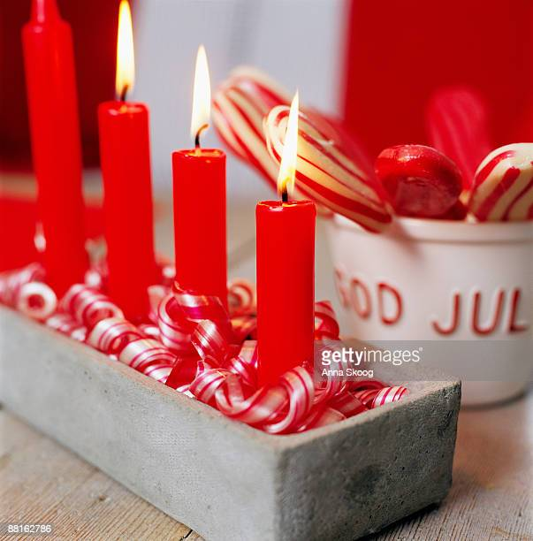 Advent candlestick with four candles lit in turn on each Sunday in Advent Sweden.