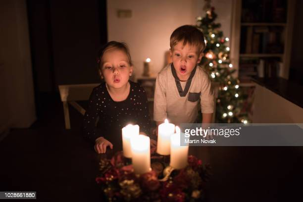 advent time - little children waiting for christmas - advent stock-fotos und bilder