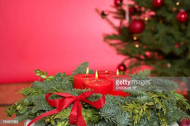 Advent wreath, Christmas tree in background