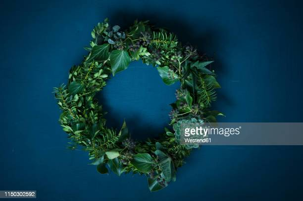 advent wreath on blue ground - wreath stock pictures, royalty-free photos & images