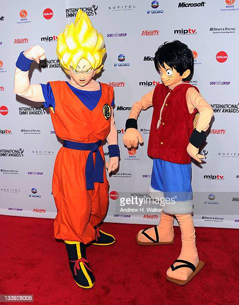 Adventure animation characters Goku and Luffy from 'One Piece' attend the 39th International Emmy Awards at the Mercury Ballroom at the New York...